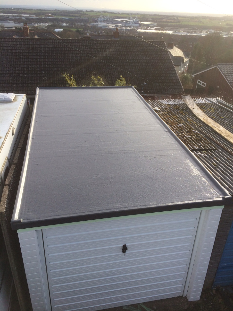 image shows grp roofing on a garage in sheffield