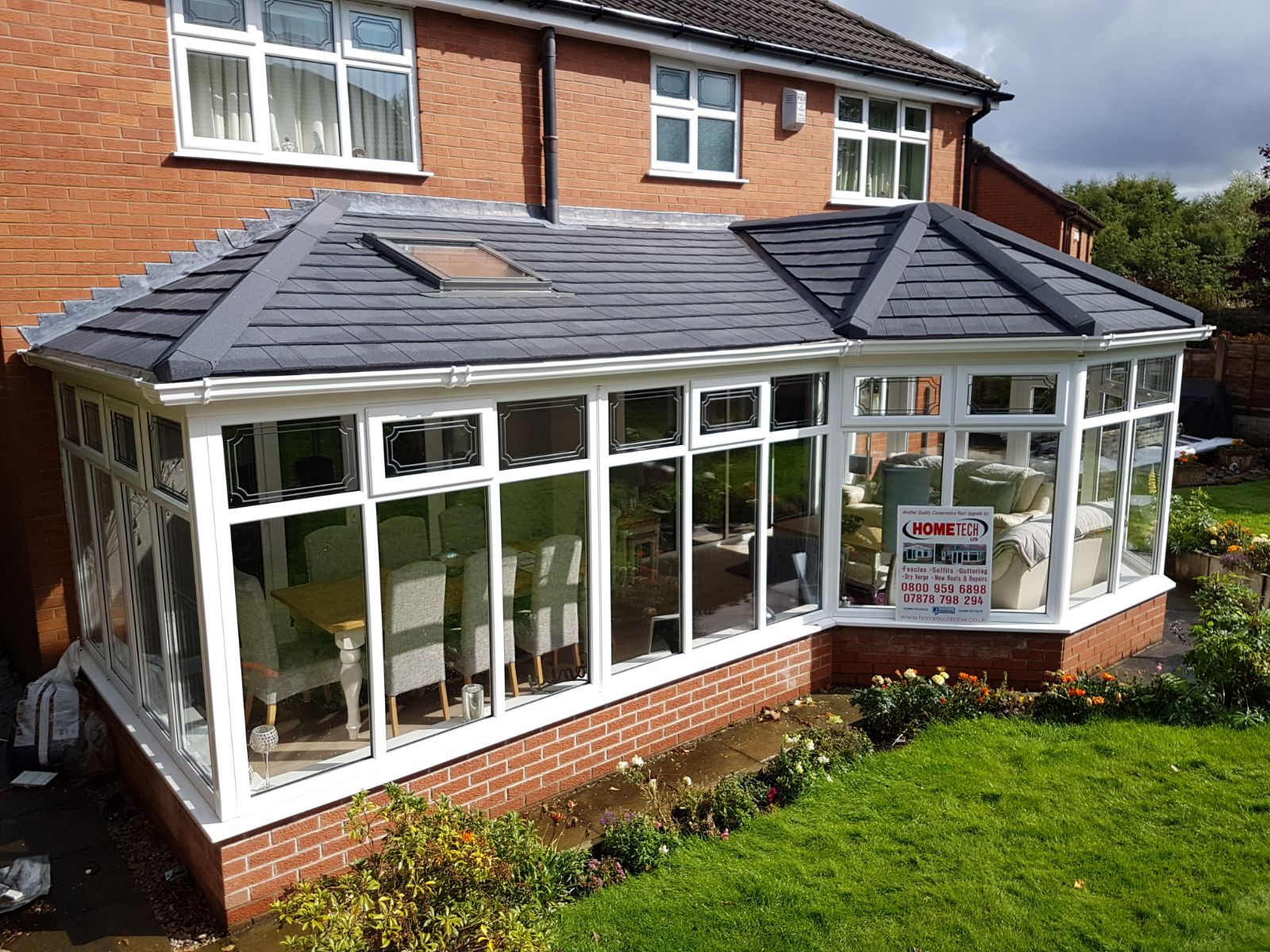 image showing conservatory with advertisement to contact a roofer in sheffield